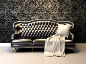 Postal: Elegante sofá con un cojín blanco