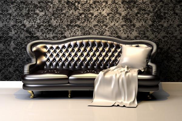 Elegante sofá con un cojín blanco