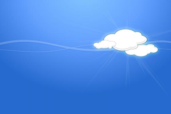Nubes y rayos de sol en un fondo azul