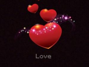 Postal: Love y corazones rojos con destellos de luz