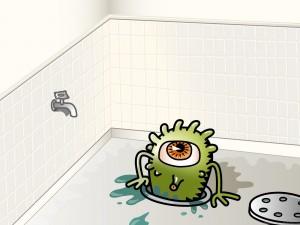 Monstruo de un solo ojo saliendo por el desagüe de la bañera