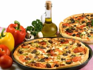 Dos ricas pizzas con vegetales
