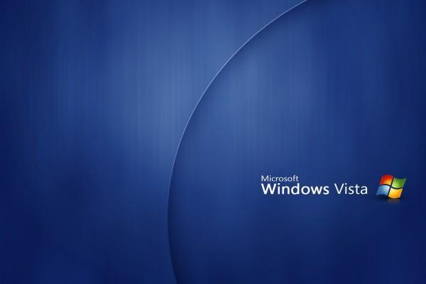 Microsoft Windows Vista en un fondo azul oscuro