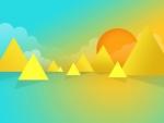 El sol detras de las montañas triangulares