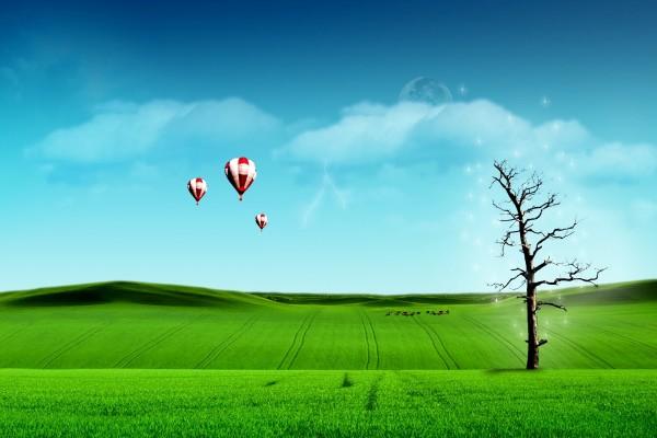 Árbol mágico y globos en un gran prado verde