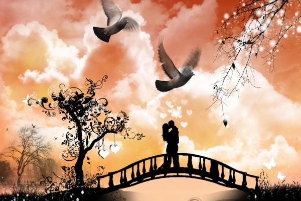 Enamorados besándose sobre el puente