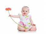 Un bella beba con una flor