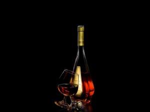 Postal: Botella y copa de coñac