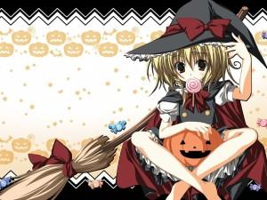 Bruja comiendo caramelos en la noche de Halloween