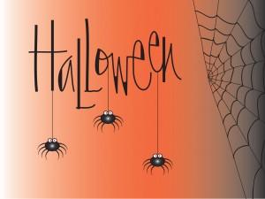 """Arañas colgando de las letras de """"Halloween"""""""