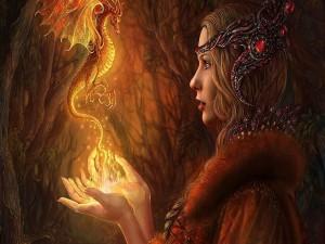 Un pequeño dragón de fuego en las manos de una mujer