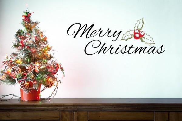 Pequeño árbol decorado y Feliz Navidad