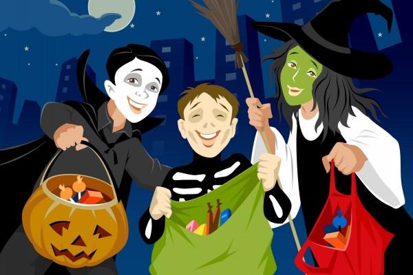 Tres niños disfrazados y pidiendo dulces en el día de Halloween