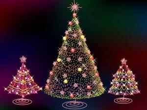 Postal: Tres brillantes árboles de Navidad