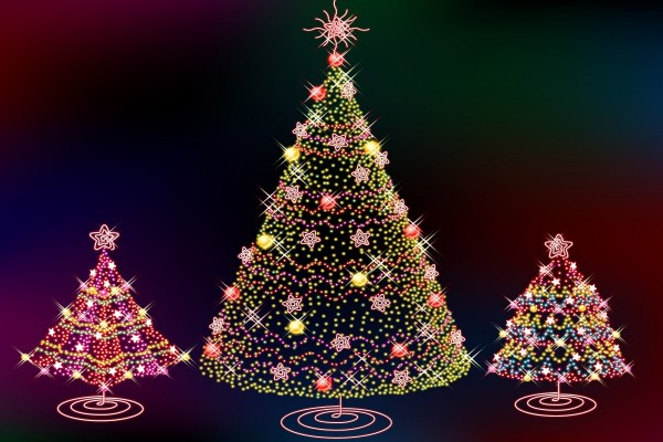 Tres brillantes árboles de Navidad