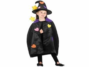 Niña con un disfraz de bruja para Halloween