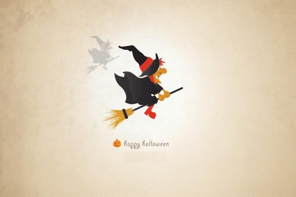 """Una bruja volando en su escoba y deseando un """"Feliz Halloween"""""""