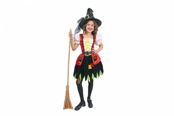 Una jovial niña con un disfraz de bruja para Halloween