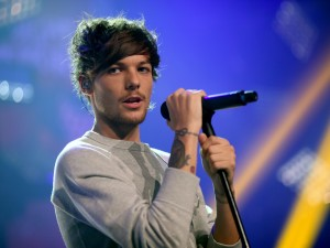 "Louis Tomlinson en un concierto de ""One Direction"""