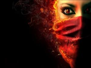 Mujer en llamas con un pañuelo en la cara