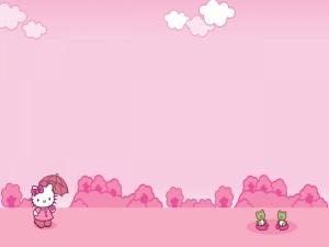 Postal: Hello Kitty paseando hacia unas ranitas verdes