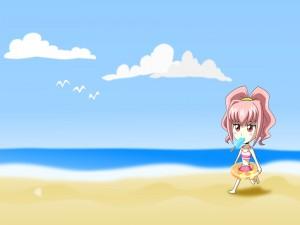 Una nena caminando en la playa y comiendo un helado