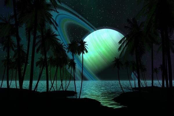 Un gran planeta con anillos visto desde las palmeras