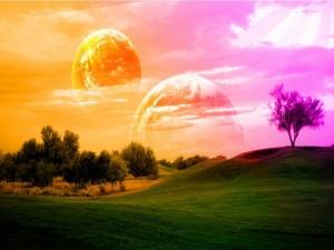 Postal: Planetas en un cielo de colores