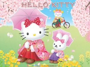 Postal: Hello Kitty y su amiga sentadas entre cerezos en flor