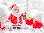 Papá Noel junto a unas bolas rojas