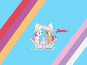 Pequeños pony en un barquito de papel