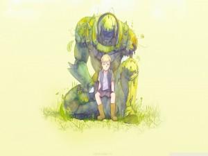 Niño sentado sobre un robot cubierto de hierba