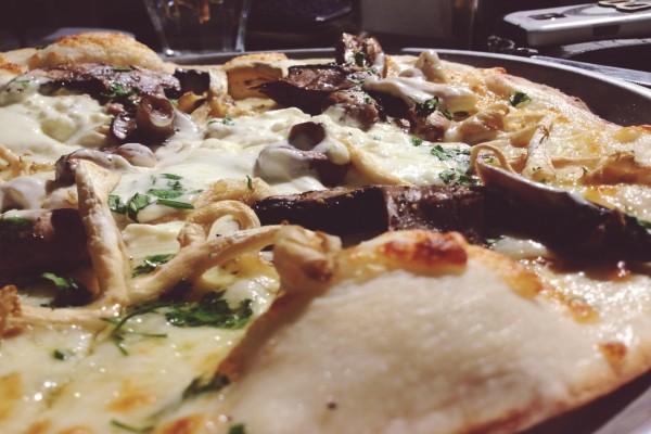 Pizza con mucho queso