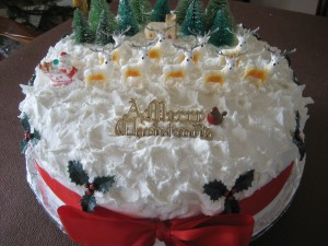 Una tarta de Navidad con renos y Santa