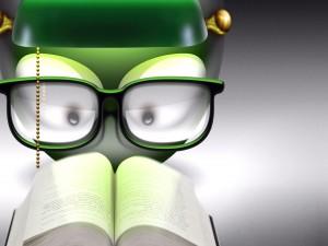Emoticon leyendo un libro