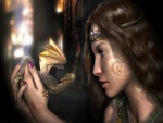 Pequeño dragón en manos de una mujer