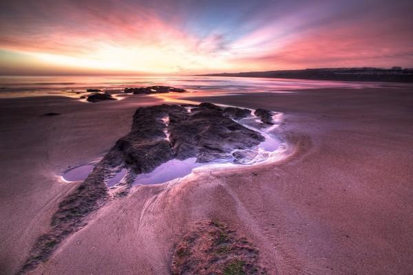 Espectacular cielo sobre una gran playa