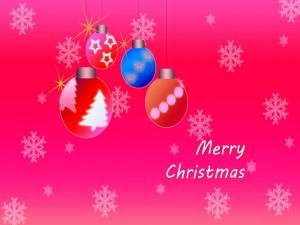 Postal: ¡Feliz Navidad! en un fondo rosa