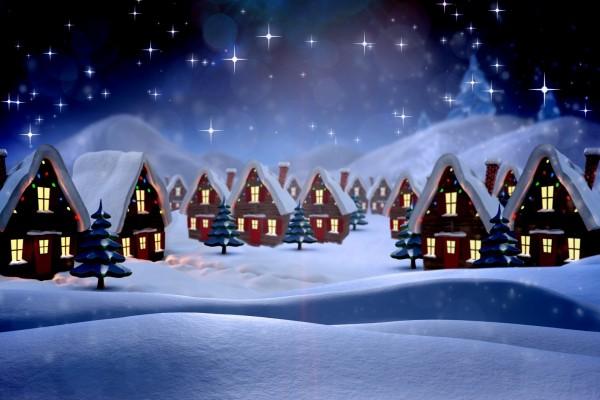 Casitas cubiertas de nieve la noche de Navidad