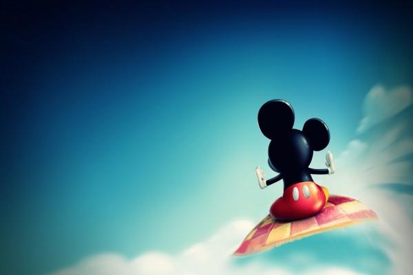 Mickey Mouse volando en una alfombra mágica