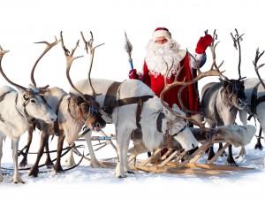 Santa Claus junto a sus renos