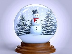 Postal: Bola de cristal con un muñeco de nieve en su interior