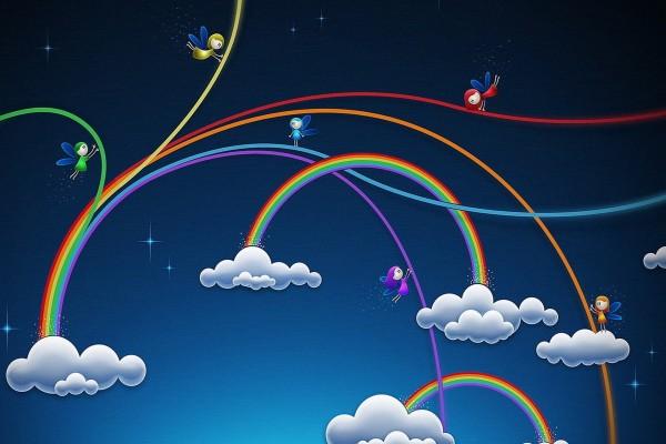 Hadas montando un gran arcoíris