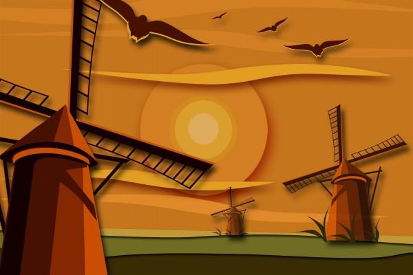 Aves volando sobre los molinos de viento