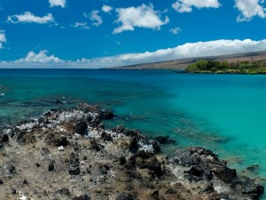 Postal: Aguas azuladas junto a la costa