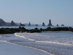 Postal: Formaciones rocosas en la playa y el mar