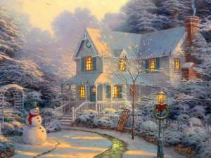 Una casa cubierta de nieve al llegar la Navidad