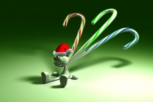Bastones de caramelo sobre un muñeco navideño