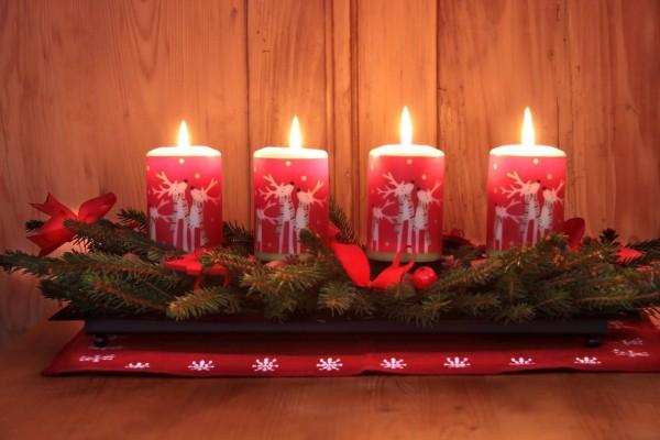 Centro de mesa con originales velas encendidas