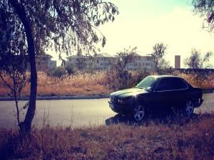 Postal: Sol brillando sobre un BMW